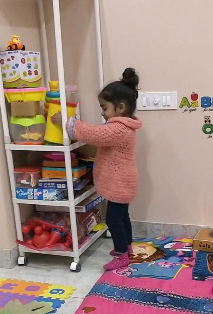kid arranging toys